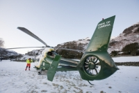 Lake-District;Cumbria;National-Park;UK;hill;winter;cold;snow;snowpack;freezing;weather;mountain;mountain-rescue;rescue;paramedic;air-ambulance;doctor;treatment;casualty;injured;emergency-services;evacuation;high-vis;yellow;Langdale
