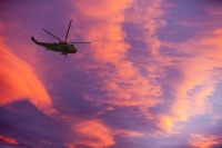 sky;weather;cloud;cumulus;water-vapour;red;colour;glow;warm;sunset;dusk;evening;helicopter;RAF;Sea-King;hover;flight;flying;rotor;rotor-blades;search-and-rescue;rescue
