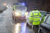 weather;extreme-weather;environment;rain;rainfall;exceptional;global-warming;deluge;climate-change;Cumbria;Lake-District;flood;flooding;flood-damage;destruction;water;water-power;river;flood-damage;policeman;road-block;stopping;torrential;downpour