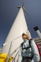 Southern-Uplands;Biggar;Scotland;UK;hill;moor;moorland;sky;blue;climate-change;carbon;Borders;wind-turbine;wind-farm;renewable;renewable-energy;Clyde-Wind-farm;blade;turbine-blade;wind-energy;wind-power;carbon-neutral;clean;green;global-warming;electricity;generating;generation;yellow;woman;female;walker;steps;sitting;scarf;sunglasses;sunlight;sunny