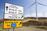 Southern-Uplands;Biggar;Scotland;UK;hill;moor;moorland;sky;blue;climate-change;carbon;Borders;wind-turbine;wind-farm;renewable;renewable-energy;Clyde-Wind-farm;blade;turbine-blade;wind-energy;wind-power;carbon-neutral;clean;green;global-warming;electricity;generating;generation;signage;sign;sign-post;yellow;colourful;array;exit;turning-area