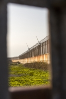 Cumbira;UK;Haverigg;prison;fence;security;razor-wire;high-fence;perimeter;secure;safety;HMP;renewable;renewable-energy;wind;wind-power;wind-farm;wind-turbine;carbon-neutral;climate-change;global-warming;generation;electricity;green;compound