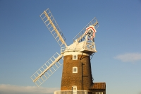 windmill;Cley-Next-the-Sea;North-Norfolk;UK;coast;wind-power;building;architecture;sail;house;red;blue;sky;clear