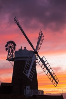 windmill;Cley-Next-the-Sea;North-Norfolk;UK;coast;wind-power;building;architecture;sail;house;sky;clear;dusk;evening;sunset;glow;orange;colourful